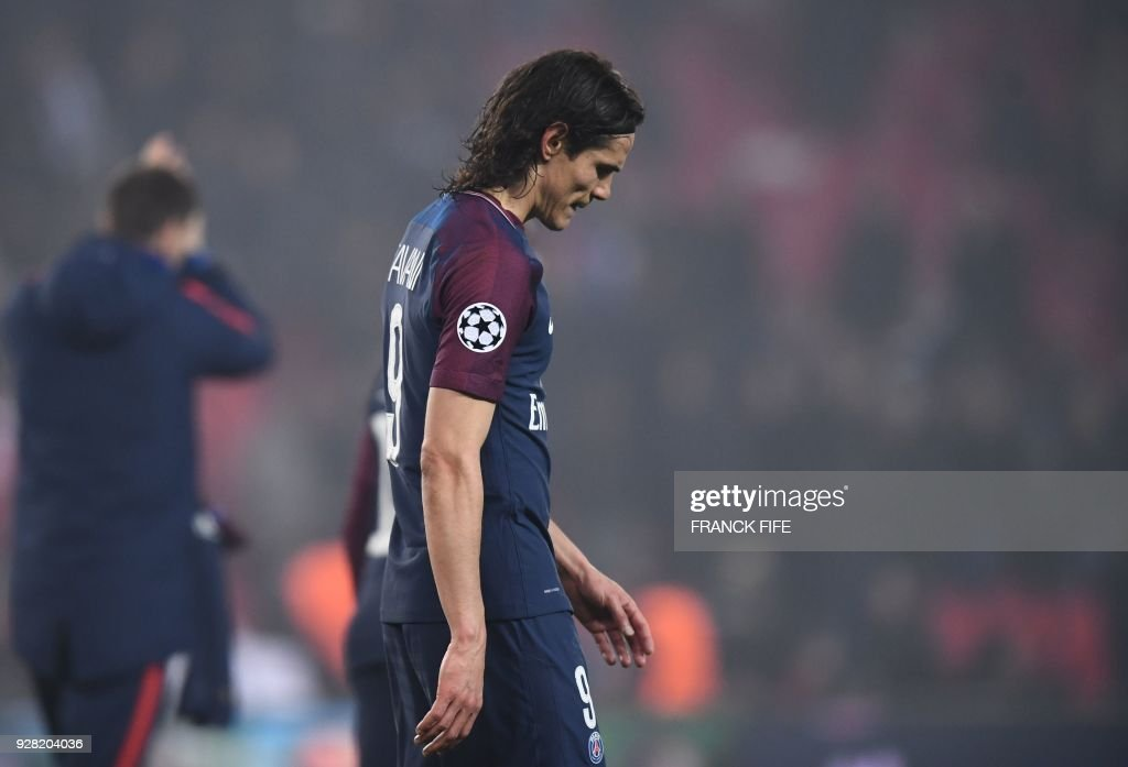 TOPSHOT - Paris Saint-Germain's Uruguayan forward Edinson Cavani reacts after losing the UEFA Champions League round of 16 second leg football match between Paris Saint-Germain (PSG) and Real Madrid on March 6, 2018, at the Parc des Princes stadium in Paris. /