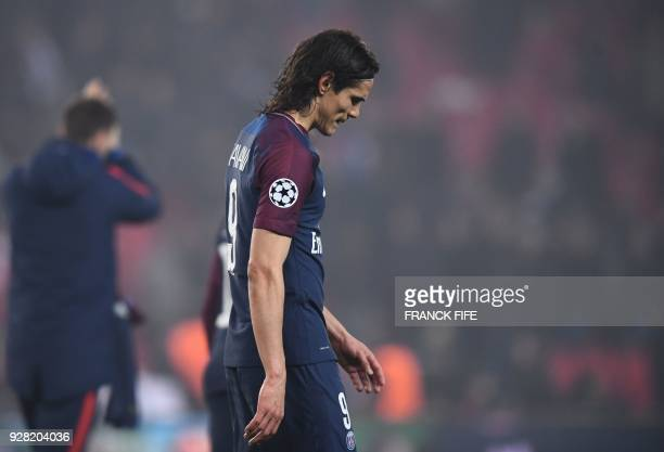 Paris Saint-Germain's Uruguayan forward Edinson Cavani reacts after losing the UEFA Champions League round of 16 second leg football match between...