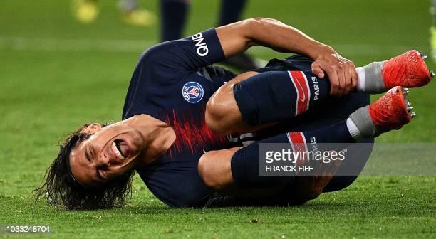 Paris Saint-Germain's Uruguayan forward Edinson Cavani reacts during the French L1 football match between Paris Saint-Germain and Saint-Etienne at...