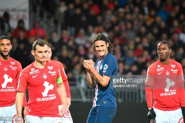 Paris Saint-Germain's Uruguayan forward Edinson Cavani reacts next to Brest's players during the French L1 football match between Stade Brestois 29...