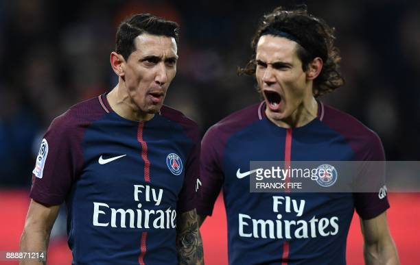 Paris SaintGermain's Uruguayan forward Edinson Cavani reacts next to Paris SaintGermain's Argentinian forward Angel Di Maria after he scored the...
