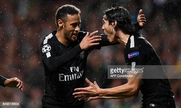 Paris SaintGermain's Uruguayan forward Edinson Cavani reacts with Paris SaintGermain's Brazilian forward Neymar after scoring a goal during the UEFA...