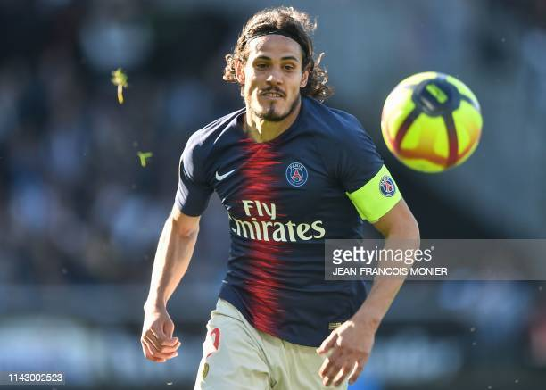 Paris SaintGermain's Uruguayan forward Edinson Cavani runs for the ball during the French L1 football match between Angers and Paris SaintGermain on...