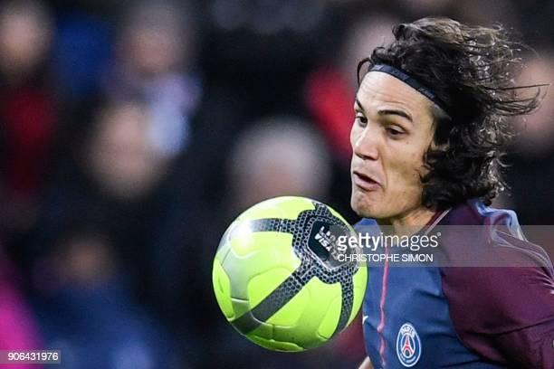 Paris SaintGermain's Uruguayan forward Edinson Cavani runs with the ball during the French L1 football match between Paris SaintGermain and Dijon on...