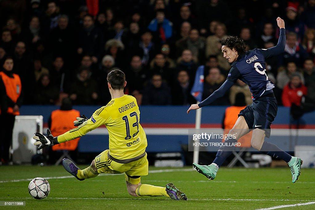 Paris Saint-Germain's Uruguayan forward Edinson Cavani (R) scores a goal past Chelsea's Belgian goalkeeper Thibaut Courtois (L) during the Champions League round of 16 first leg football match between Paris Saint-Germain (PSG) and Chelsea FC on February 16, 2016, at the Parc des Princes stadium in Paris.