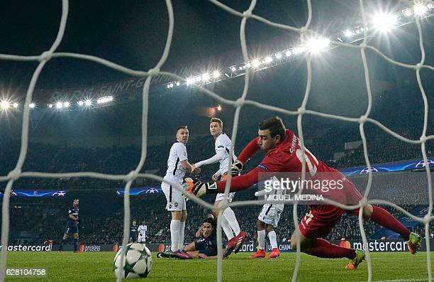 Paris SaintGermain's Uruguayan forward Edinson Cavani scores a goal during the UEFA Champions League Group A football match between Paris...