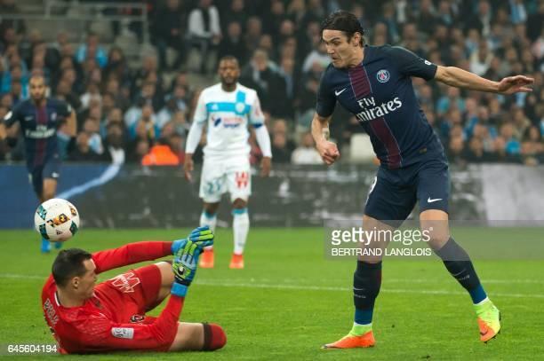 Paris Saint-Germain's Uruguayan forward Edinson Cavani scores despite Olympique de Marseille's French goalkeeper Yohann Pele during the French L1...