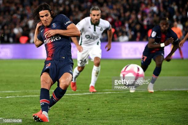Paris Saint-Germain's Uruguayan forward Edinson Cavani shoots and scores a penalty kick during the French L1 football match between Paris...