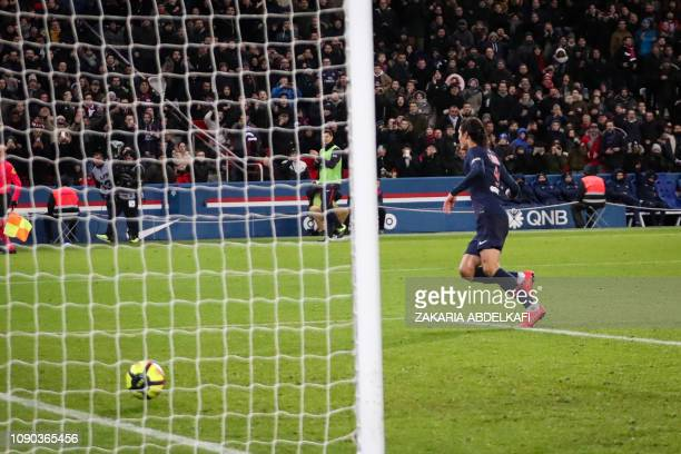 Paris SaintGermain's Uruguayan forward Edinson Cavani shoots and scores a goal during the French L1 football match between Paris SaintGermain and...
