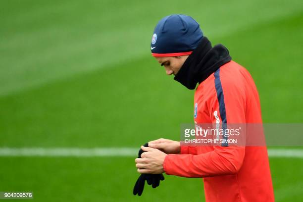 Paris SaintGermain's Uruguayan forward Edinson Cavani takes part in a training session on January 12 2018 at the Camp des Loges in SaintGermainenLaye...