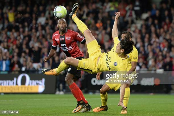 Paris SaintGermain's Uruguayan forward Edinson Cavani tries to score a goal under the look of Guingamp's French defender Jeremy Sorbon during the...
