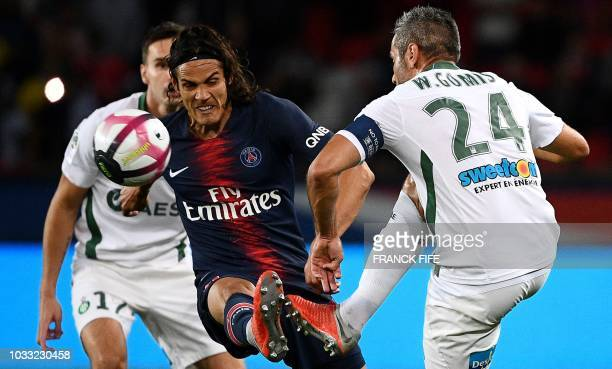 Paris Saint-Germain's Uruguayan forward Edinson Cavani vies for the ball with Saint-Etienne's French defender Loic Perrin during the French L1...