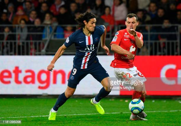 Paris Saint-Germain's Uruguayan forward Edinson Cavani vies for the ball with Brest's French midfielder Julien Faussurier during the French L1...