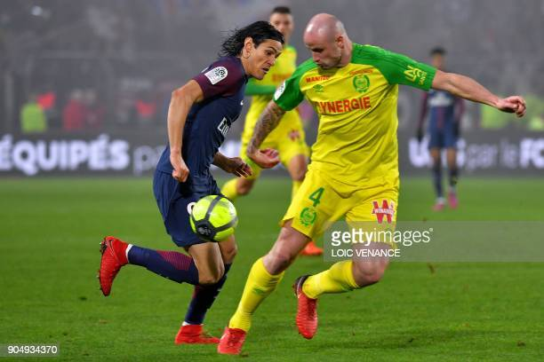 Paris SaintGermain's Uruguayan forward Edinson Cavani vies with Nantes' French defender Nicolas Pallois during the French L1 football match between...