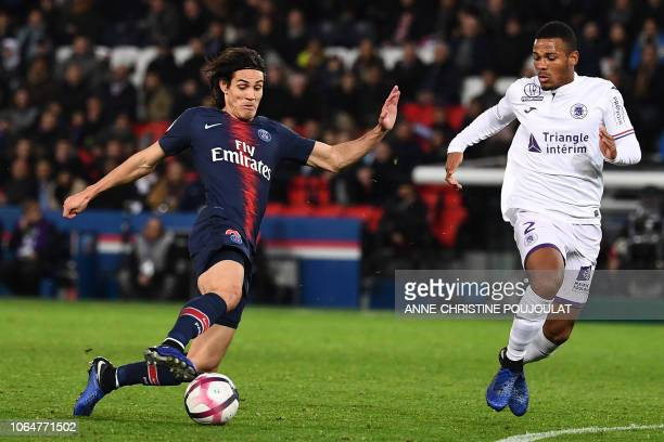 TOPSHOT Paris SaintGermain's Uruguayan forward Edinson Cavani vies with Toulouse's French defender Kelvin Amian during the French Ligue 1 football...