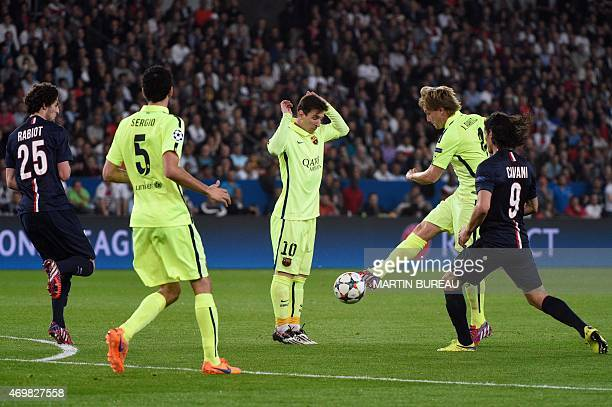 Paris SaintGermain's Uruguayan forward Edinson Cavani vies with Barcelona's Croatian midfielder Ivan Rakitic next to Barcelona's Argentinian forward...