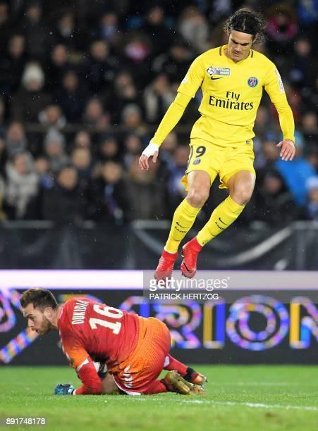 Paris SaintGermain's Uruguayan forward Edinson Cavani vies with Strasbourg's French goalkeeper Alexandre Oukidja during the French League Cup round...