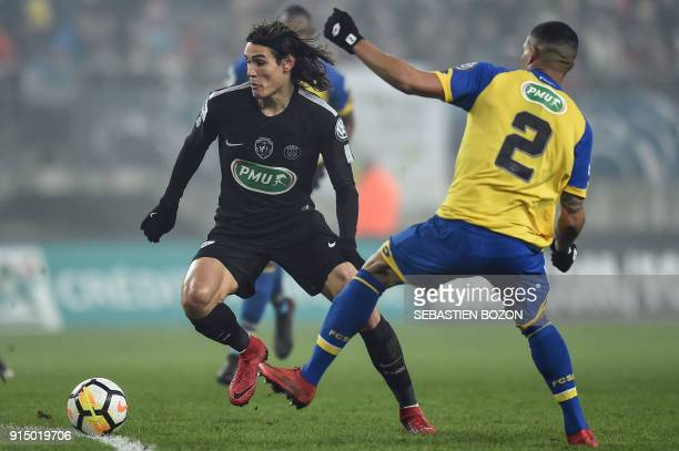 Paris SaintGermain's Uruguayan forward Edinson Cavani vies with Sochaux's French defender Mickael Alphonse during the French Cup round of sixteen...
