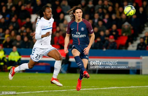 Paris SaintGermain's Uruguayan forward Edinson Cavani vies with Strasbourg's Burkinabe defender Bakary Kone during the French Ligue 1 football match...