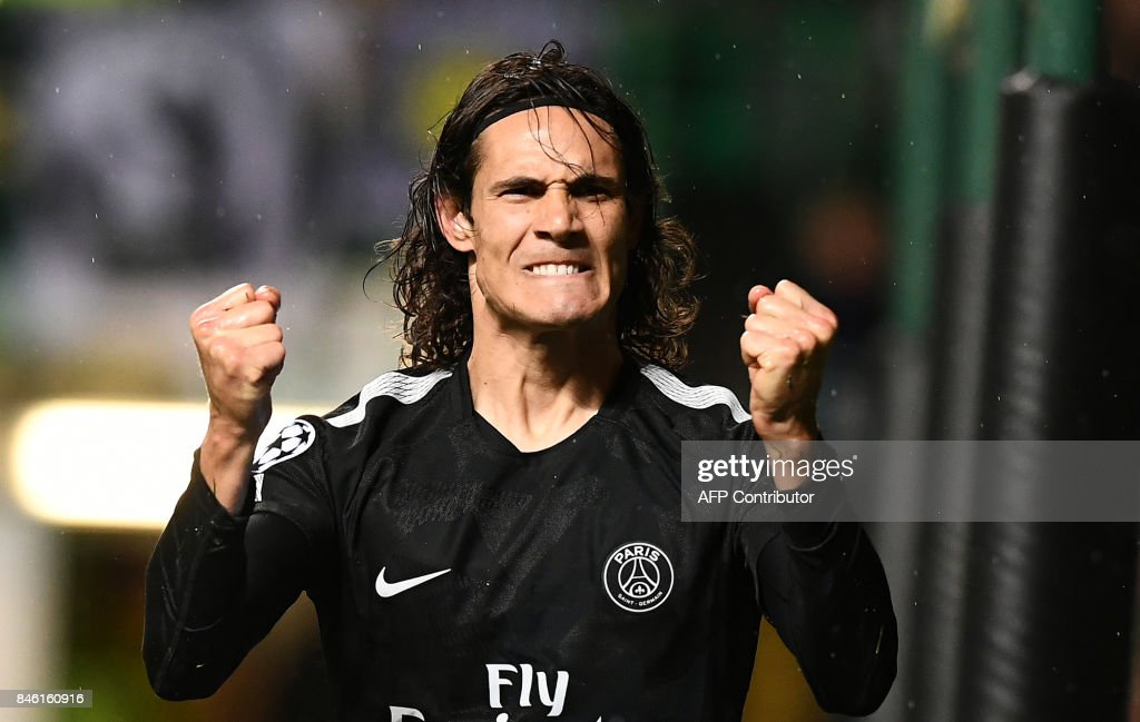 Paris Saint-Germain's Uruguayan striker Edinson Cavani celebrates after scoring his second goal, their fifth during the UEFA Champions League Group B football match between Celtic and Paris Saint-Germain (PSG) at Celtic Park in Glasgow, on September 12, 2017. PSG won the game 5-0. / AFP PHOTO / Franck FIFE
