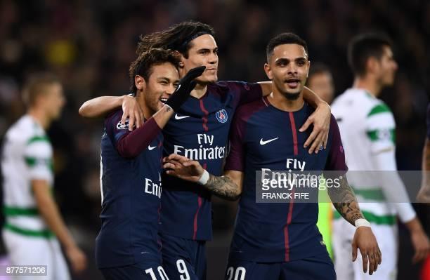 Paris SaintGermain's Uruguayan striker Edinson Cavani celebrates after scoring with teammates Paris SaintGermain's Brazilian striker Neymar and Paris...