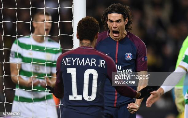 Paris SaintGermain's Uruguayan striker Edinson Cavani celebrates with teammate Brazilian striker Neymar after scoring his team's third goal during...