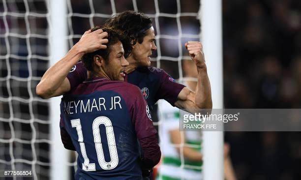 Paris SaintGermain's Uruguayan striker Edinson Cavani celebrates with teammate Brazilian striker Neymar after scoring during the UEFA Champions...