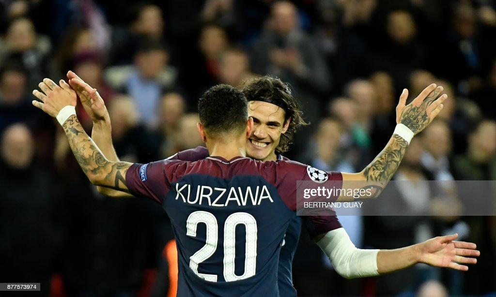 Paris Saint-Germain's Uruguayan striker Edinson Cavani (R) celebrates with teammate French defender Layvin Kurzawa after scoring during the UEFA Champions League Group B football match between Paris Saint-Germain (PSG) and Glasgow Celtic at Parc des Princes Stadium in Paris on November 22, 2017. /