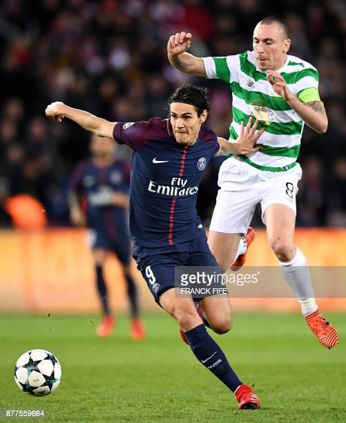 Paris SaintGermain's Uruguayan striker Edinson Cavani fights for the ball with Celtic's Scottish midfielder Scott Brown during the UEFA Champions...