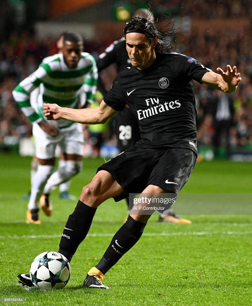 Paris Saint-Germain's Uruguayan striker Edinson Cavani scores their third goal from the penalty spot during the UEFA Champions League Group B football match between Celtic and Paris Saint-Germain (PSG) at Celtic Park in Glasgow, on September 12, 2017. /
