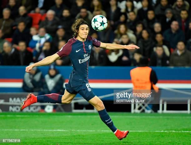 Paris SaintGermain's Uruguayan striker Edinson Cavani watches the ball during the UEFA Champions League Group B football match between Paris...