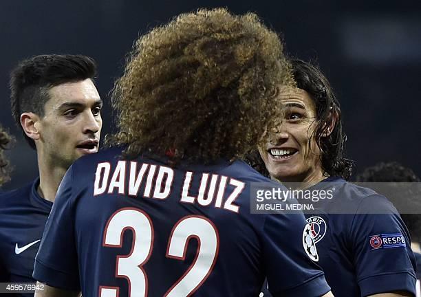 Paris SaintGermain's Uruguyan forward Edinson Cavani smiles as he celebrates with Paris SaintGermain's Argentinian midfielder Javier Pastore and...