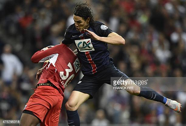 Paris SaintGermain's Uruguyan forward Edinson Cavani vies with Auxerre's goalkeeper Donovan Leon during the French Cup final football match between...