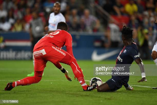 Paris SaintGermain's US forward Tim Weah vies with Caen's Congolese goalkeeper Brice Samba during the French L1 football match between Paris...