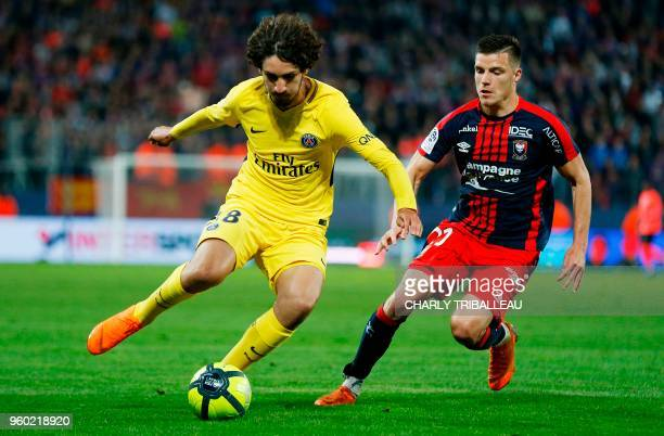 Paris SaintGermain's Yacine Adli vies for the ball with Caen's French defender Frederic Guilbert during the French L1 football match between Caen and...