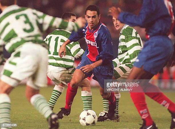 Paris SaintGermain's Youri Djorkaeff breaks through the Glasgow Celtic defense during their European Cup Winners Cup match in Paris 19 October Paris...