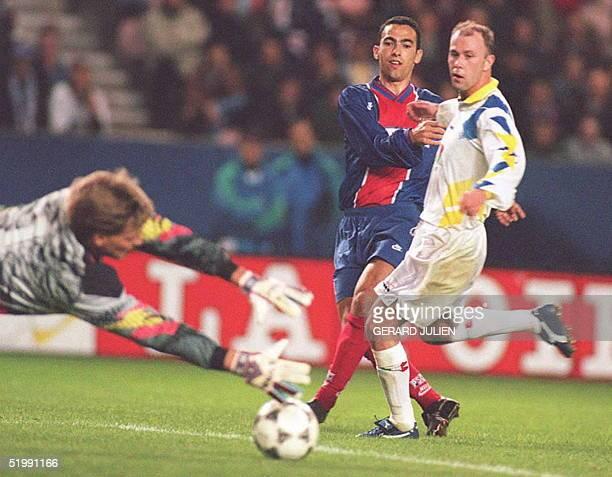 Paris SaintGermain's Youri Djorkaeff tries to shoot past Molde's goalie Bakke as an unidentified Norwegian defender rushes in during their second...