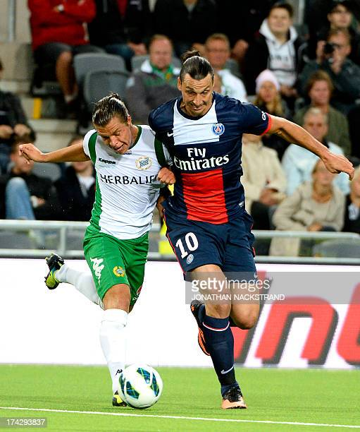 Paris SaintGermain's Zlatan Ibrahimovic and Hammarby's Erik Figueroa vie for the ball during a friendly football match between PSG and Hammarby IF at...