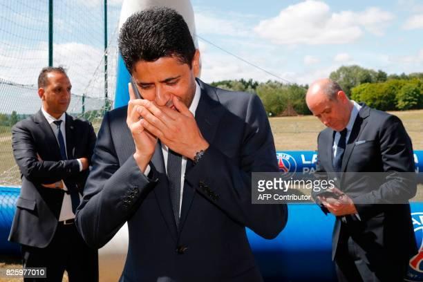 Paris Saintt Germain's chairman and CEO Nasser AlKhelaifi phones next to Paris Saint Germain's sporting director Antero Henrique during a visit to...