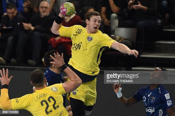 Paris' Sander Sagosen takes a shot during the French D1 handball match between Montpellier and Paris at the Sud de France Arena hall on December 21...