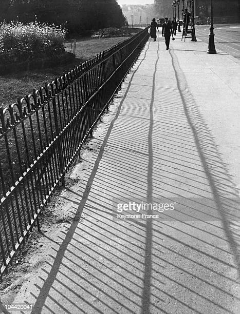 Paris Shadow Of A Garden'S Fence On A Sidewalk Of Paris In The Month Of September Around 1930