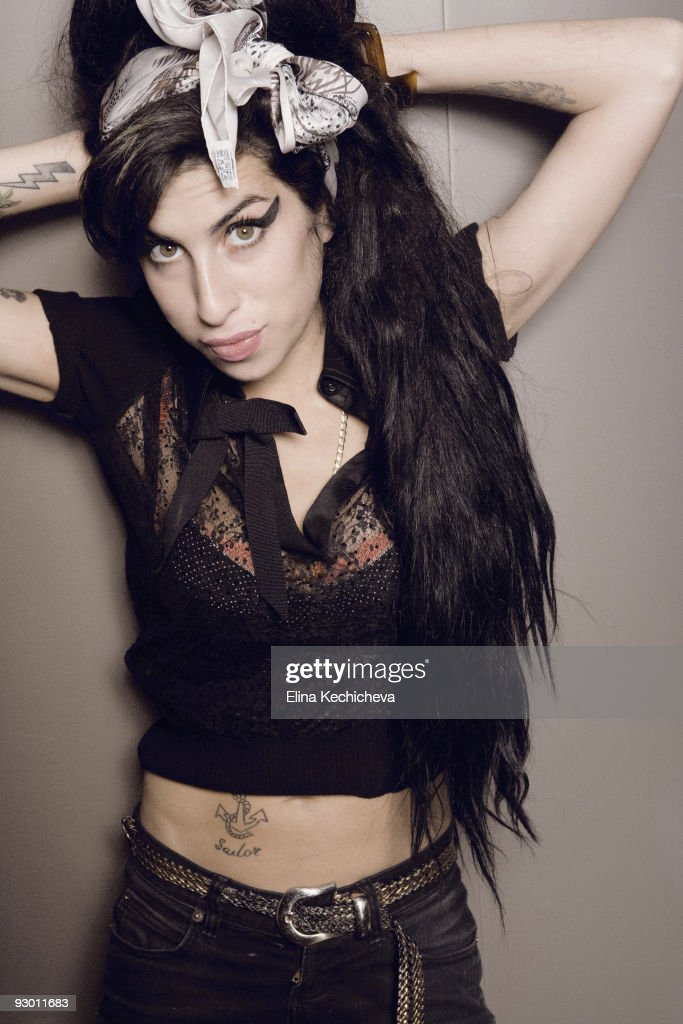 singer Amy Winehouse poses at a portrait session for Jalouse in Paris on January 25, 2008. (photo by Elina Kechicheva/Contour by Getty Images).