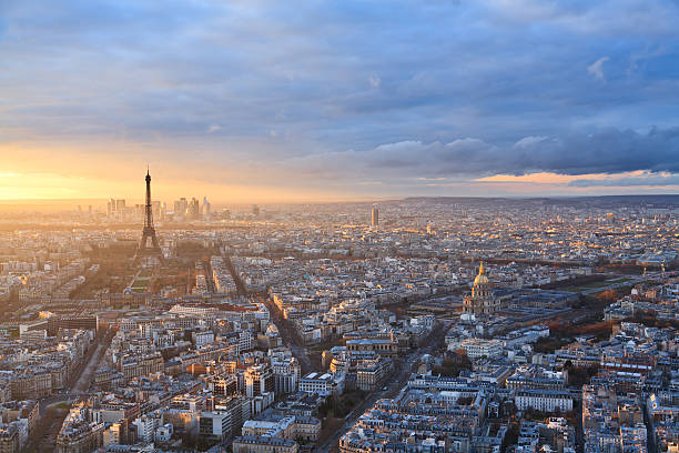 Free paris skyline images pictures and royalty free stock photos paris skyline under a dramatic sky at sunset voltagebd Choice Image