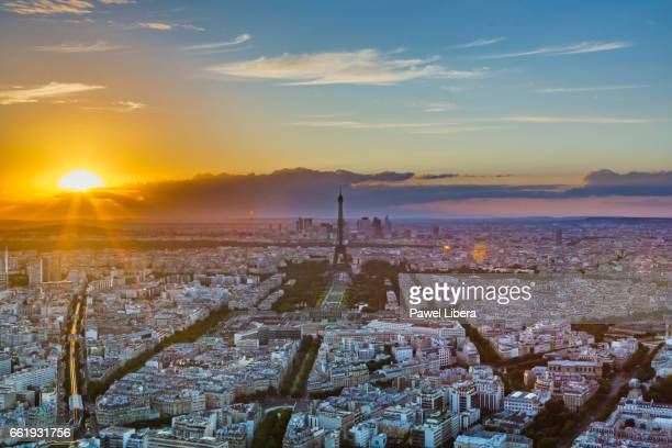 Paris skyline with Eiffel Tower at sunset.