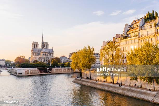Paris skyline with Seine rive, Notre-Dame Cathedral during sunset, Paris, France