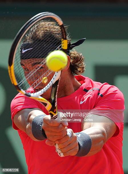 Spain's Rafael Nadal hits a return to Italy's Simone Bolelli during their Men's Singles 1st Round tennis match of the French Open tennis tournament...