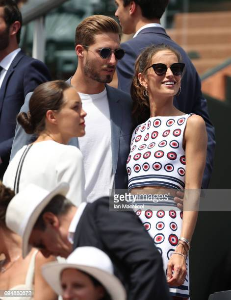 Paris St Germain goalkeeper Kevin Trapp and Izabel Goulart are seen Prior to the Men's Singles Final between Rafael Nadal of Spain and Stan Wawrinka...
