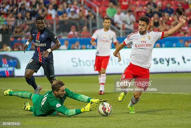 Paris St Germain's Serge Aurier and goalkeeper Kevin Trapp and SL Benfica's Pizzi in the International Champions Cup in Toronto