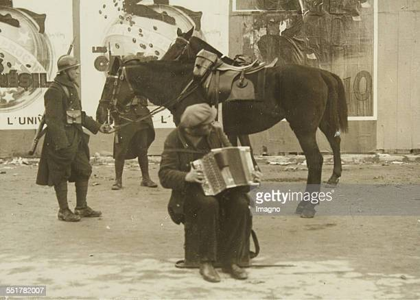 Paris Street scene with an unemployed accordion player and two armed horsemen 1929 Photograph