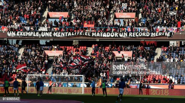 Paris' supporters cheer on their team with a banner reading 'An example a mentality El Matador a deserved record' during the French Ligue 1 football...